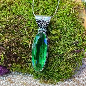 Peridot ethnic style pendant on sterling chain